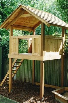 Western red cedar play house with ladder and play bark