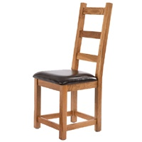 Canterbury Rustic Oak Dining Chairs Set of 2    Two rustic oak dining chairs with faux leather seat pads  Beautiful rustic style oak furniture  Self-assembly required  The Rustic Canterbury Oak Range are authentic, durable and quality pieces. Treated with tinted wax to darken the oak to create a traditional finish that looks like well loved rather than brand new furniture.