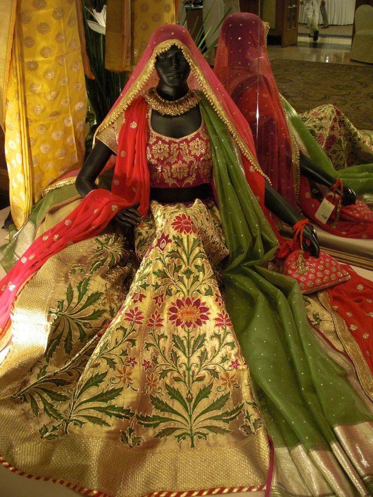 Stunning example of a traditional wedding lehenga from designer Vidhi Singhania. Gold brocade lehenga with two dupattas.