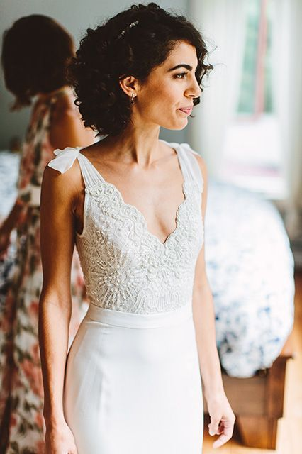 "The bride went with a two-piece dress by Israeli designer Lihi Hod. ""I love crop tops and the two piece wedding look, but still wanted something classic,"" says Carpanzano Durcan. ""This custom-fit gown checked all the boxes and I couldn't have been happier with it. "" #refinery29 http://www.refinery29.com/wedding-day-honoring-loved-one#slide-1"