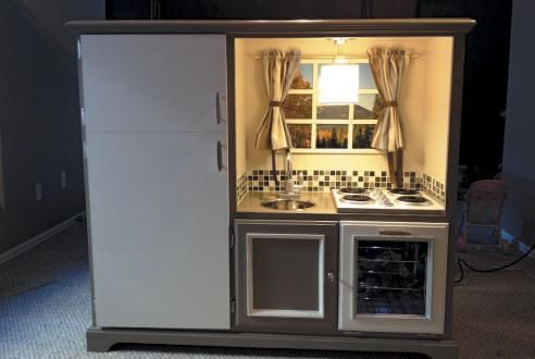 another play kitchen from a entertainment center-love all the realistic/high quality touches! A tile backsplash?!! Awesome!