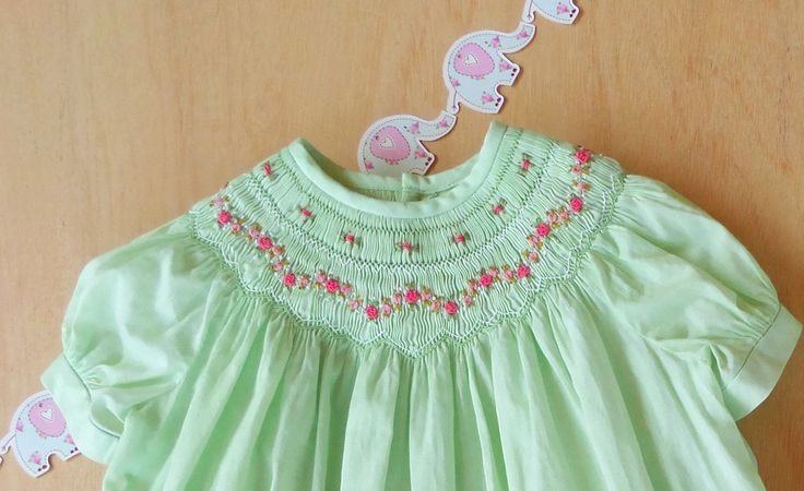 Vintage garden  Lovely and delicate girl's bishop dress is made in a soft mint voile, hand embroidery in vivid garden colours like green and pink  on a delicate hand smocking across the neckline.   www.facebook.com/a.b.timelesscouture