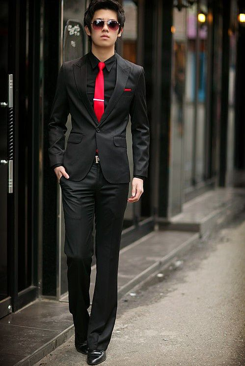 Black slim fit suit with red tie.... I will be rocking this, real soon!!