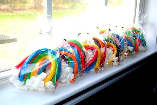Colourful rainbow treat bags made with marshmallow cloud and sweet laces. Perfect for a Rainbow Unicorn party...