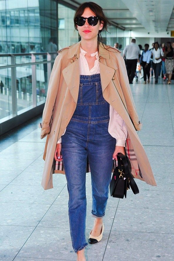 September 2nd 2013. Alexa touched down at Heathrow Airport wearing blue denim dungarees over a white shirt and a camel Burberry trench coat accessorized with cream and black toe-cap Chanel flat ballet pumps, black leather satchel bag and black sunglasses.