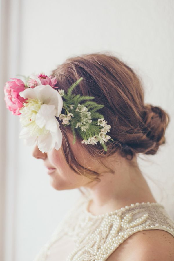 bun + floral crown, photo by nbarrett photography http://ruffledblog.com/valentines-day-makeup #wedding #bridal #hair