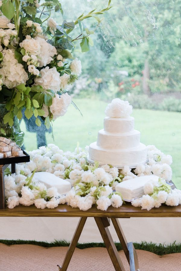 Unique all white wedding cake: http://www.stylemepretty.com/2016/08/23/english-charm-meets-brazilian-flair-for-a-cross-cultural-wedding/ Photography: Julie Michaelsen - http://www.juliemichaelsen.com/