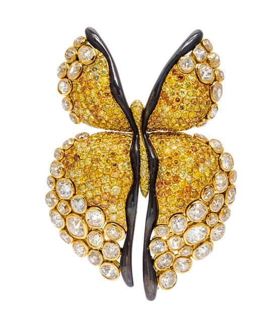 An 18 Karat Yellow Gold Colored Diamond and Diamond Butterfly Brooch