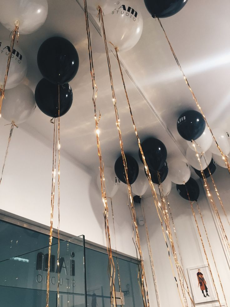 Black and white balloons with golden tassels