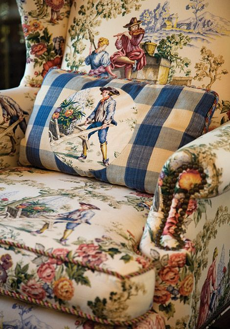 Charles Faudree...The medallion print of the pillow creates a relationship with the motif of the Queen Anne wing chair on which it rests