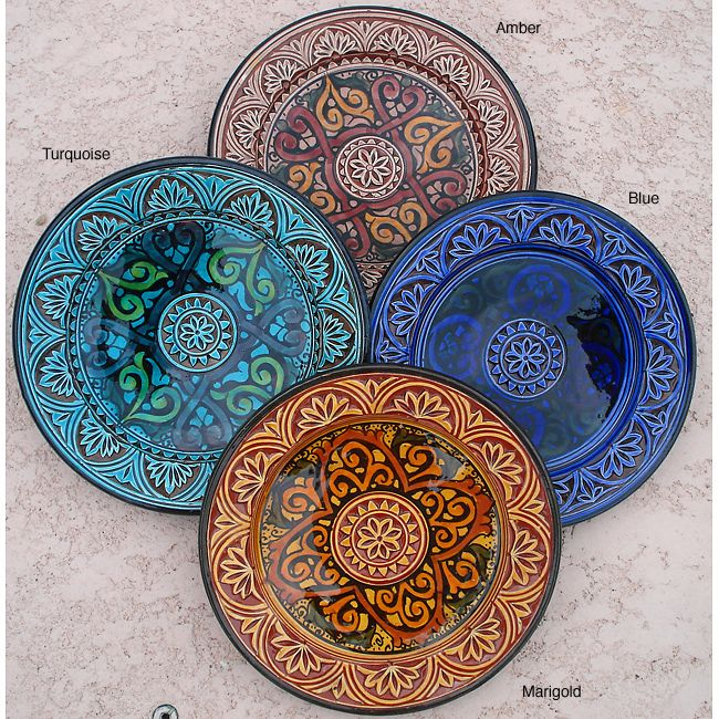 <br><li>Add exotic flair to your home decor with an engraved ceramic plate <li>Each decorative plate measures 9 inches in diameter x 2 inches deep <li> Home accessory available in Mediterranean blue, marigold, amber and turquoise color options