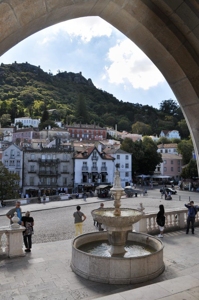 National Palace of Sintra - Parques de Sintra | The colorful hill town of Sintra boasts three palaces, an old Moorish Castle, a gothic mansion, and miles of forested hiking paths. A trip to Sintra is a chance to view man-made beauty in peaceful, garden settings.