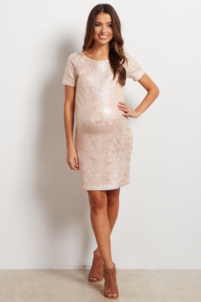 Feel flirty and ready to party in this brilliant shimmer maternity shift dress. This dress has a metallic material that gives a basic dress an out of the box element. Style this dress with a cute pair a heels to get the ultimate good time look.