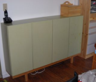 """Materials: Ivar cabinets (two, 80x30x83 cm), Ivar side/upright unit (one, 30x226 cm), shellac, paint, varnish, wood glue, screws. Optional: Rationell Door Damper (4)    Description: I had some Ivar cabinets and some Ivar shelving in my living room. But I wanted a more """"grown-up"""" look. My friend/colour consultant/interior designer suggested I needed more closed storage in the living room and wondered if something could be done with the cabinets (they had already been painted for a previous…"""
