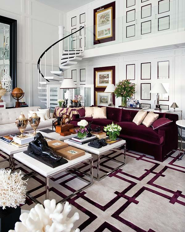 Double-height ceilings, a crazy staircase to an almost invisible 2nd floor door, the burgandy velvet sofa atop a geometric rug, huge pieces of coral on pedestals, exquisite silk stripes on the round, skirted table, four chrome-legged coffee tables, etc., etc. combine to make one of my all-time favorite living rooms. (By Pablo Paniagua, as seen in Nuevo Estilo revista de decoración)