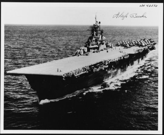 """""""USS Bunker Hill (CV-17) at sea in 1945. The original photograph is dated 16 October 1945. It has been autographed by Admiral Arleigh A. Burke, who served on board Bunker Hill in January-May 1945, while he was Chief of Staff to Admiral Marc A. Mitscher, Commander, Task Force 58."""" (US Naval History and Heritage Command: NH 42373)"""