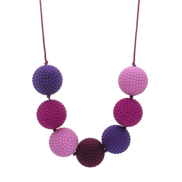 Pink and purple, with a splash of dark magenta. Soft nubs for sensory play. Drop 40cm, bead size 28mm.