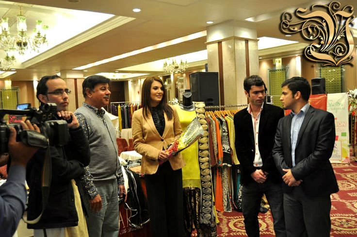 Owner of Vestiarie Shahzad Masood with AJJ TV New Channel Anchor Reham Khan (Chief Guest) and Media Sniffers Operation Director Usman Usmani in Fashion Exhibition at PC Rawalpindi at 4 March 2014.
