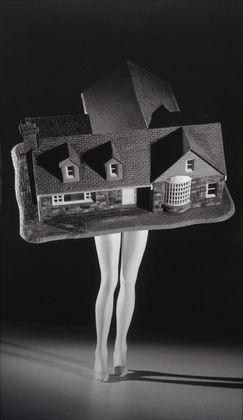 "Walking House  Laurie Simmons (American, born 1949)    1989. Gelatin silver print, 6' 11 1/4"" x 47 3/8"" (211.4 x 120.4 cm)."