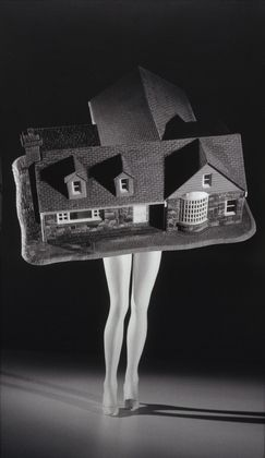 "Walking House  Laurie Simmons (American, born 1949)    1989. Gelatin silver print, 6' 11 1/4"" x 47 3/8"" (211.4 x 120.4 cm)."