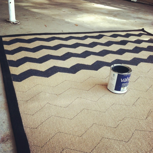 Painted a rug that I found for a steal a chevron pattern. Used a cardboard stencil that I cut out, traced it with a sharpie and painted it with porch & patio paint because it would be outside. Well worth the extra $3 for porch paint!