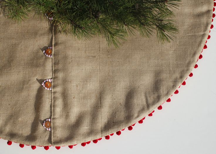 Scandinavian Christmas Tree Skirt - Rustic Burlap Tree Skirt with Wood Buttons by LittleOrangeRoom on Etsy https://www.etsy.com/listing/203049266/scandinavian-christmas-tree-skirt-rustic