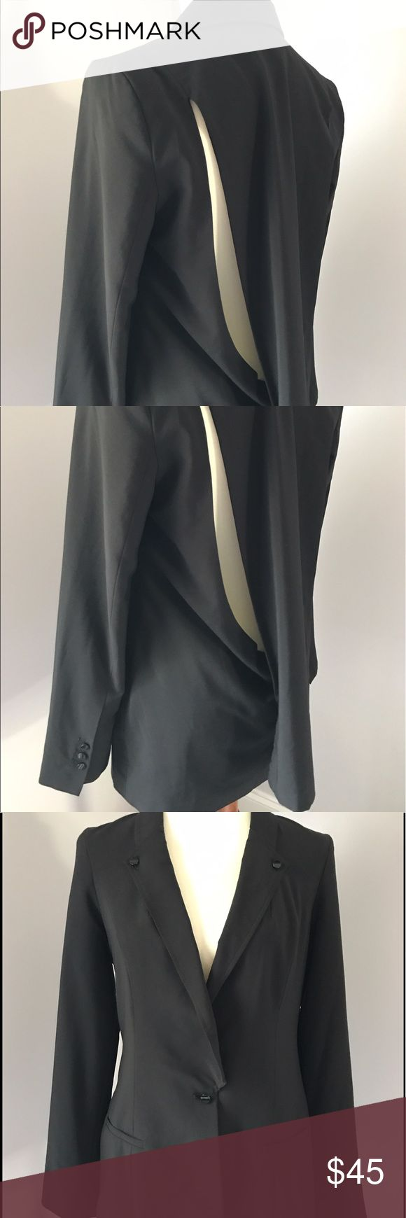 """BCBGenration Peek-a-Boo Back Blazer Jacket Size S BCBGeneration Black Blazer Jacket with a stylish peek-a-boo flap in back. •Size: Small •Single button closure •Stylish peek-a-boo flap on back •32"""" length, 38"""" bust, 25"""" shoulder to cuff •94% polyester, 6% spandex •Machine washable •Style: OIE4C878 Condition: In excellent condition. Very minor pilling and staining in interior armpit area. Item is clean and comes from a smoke free home! BCBGeneration Jackets & Coats Blazers"""