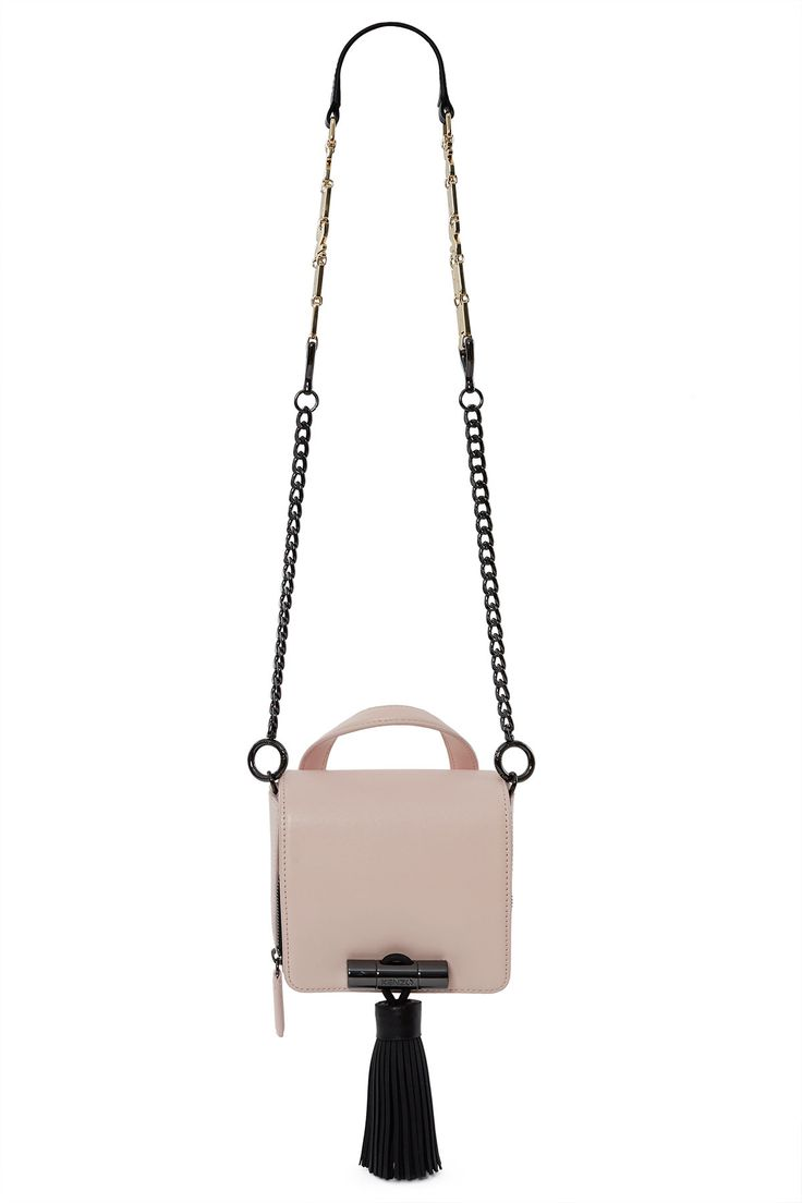 Kenzo, Sailor Bag The Sailor is inspired by the exuberant animation style of Shojo manga, and features a POP silhouette that's cute, excessive and graphic all at once., Oversized tassel, Flap over top with magnetic closure, Main interior compartment with zipper pocket and three gusseted pockets, Exterior back pocket, 100% split leather; 51% polyurethane, 35% cotton, 14% polyamide; trim: 100% rubber; trim 2: 100% zamac, Imported