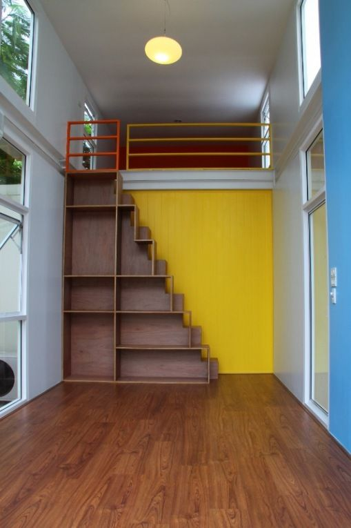 """""""Storage stairs in container house"""" - guard rail to keep you on the loft but no handrail to help you on the overly steep stairs."""