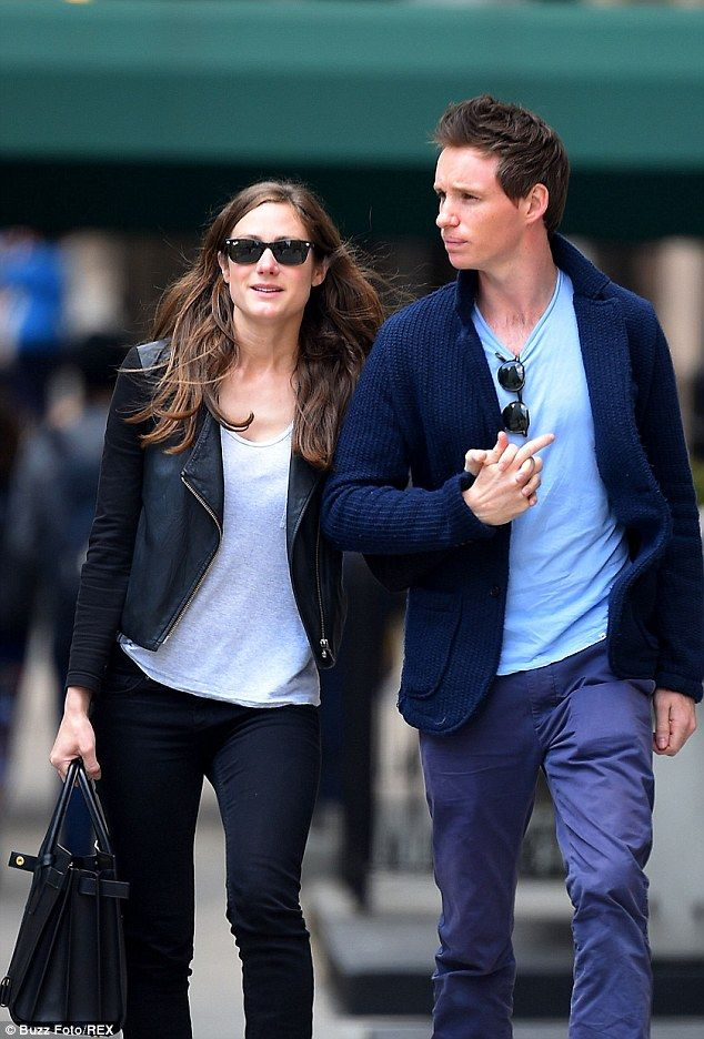 Tight: Hannah Bagshawe and Eddie Redmayne can't keep their hands of each other...