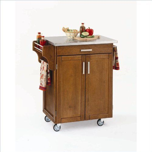 Home Styles 9001-0062 Create-a-Cart 9001 Series Cuisine Cart with Stainless Steel Top, Warm Oak, 32-1/2-Inch by Home Styles. $236.99. This cart is having a two door cabinet with an adjustable shelf within and utility drawer on metal drawer slides. This home styles 9001 series cuisine kitchen cart is a unique and refreshing solution for kitchen utility. Measures 32-1/2-inch width by 18-3/4-inch depth by 35-1/2-inch height. Available in warm oak finish. Made of solid...