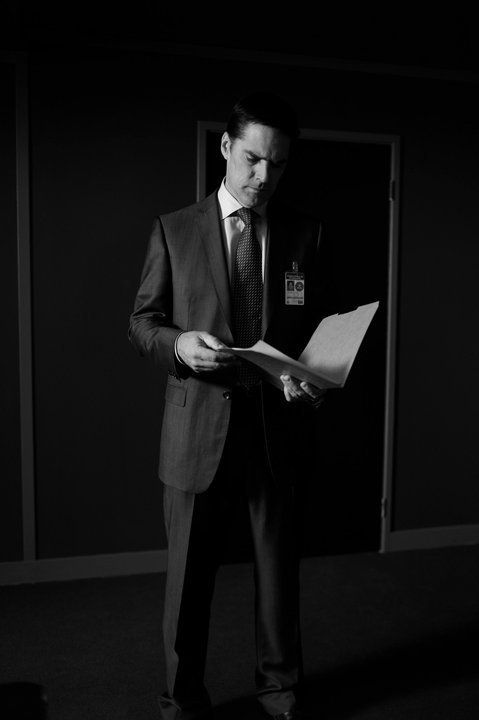 The team, led by Hotch, has to think like a criminal in order to catch them. Here, Hotch reviews a case file.