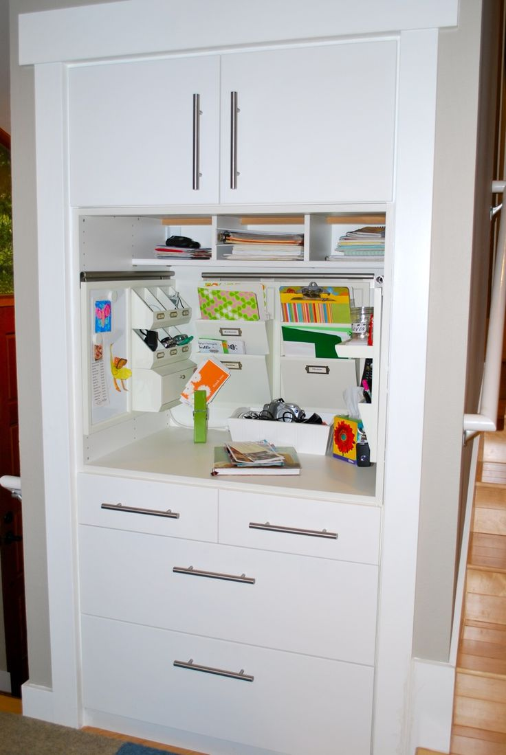ikea kitchen cabinet used to transform a hall closet into a landing center