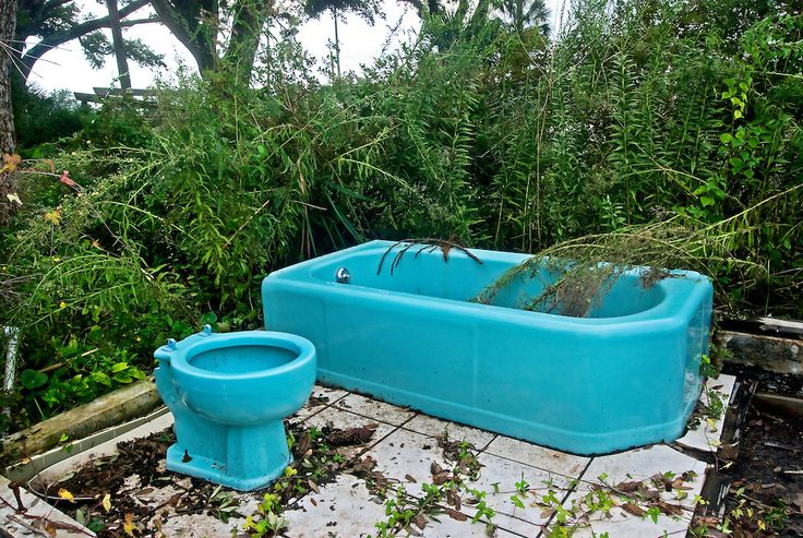 A 1970's-style turquoise bathtub and toilet are all that remain of a beachfront home on Highway 90 in Pass Christian, Mississippi, after Hurricane Katrina ravaged the Mississippi Gulf Coast. This image was taken Sept. 1, 2008, three years after Katrina. (Photo by Carmen K. Sisson/Cloudybright)