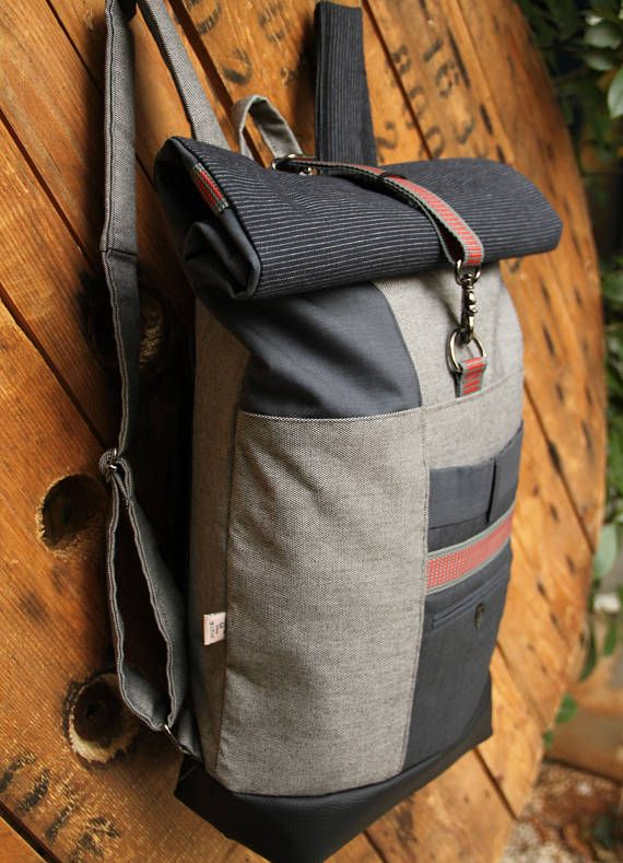 Gray upcycled rolltop rucksack using pieces from a dark gray men's suit trousers and other brand new textiles, by 'eating the goober'
