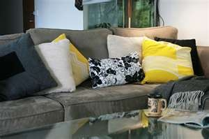 Loving grey lounge and yellow cushions