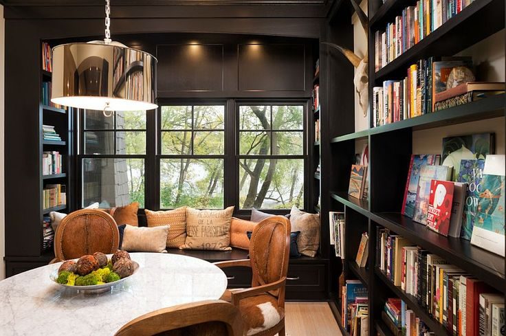 Window seat is a great addition for the cozy reading room and dining space combo [Design: Kyle Hunt & Partners / LandMark Photography]