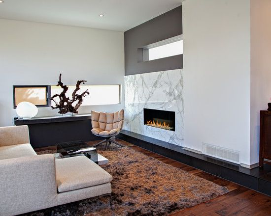 shaggy rugs in interior design contemporary living room marble wall fireplace