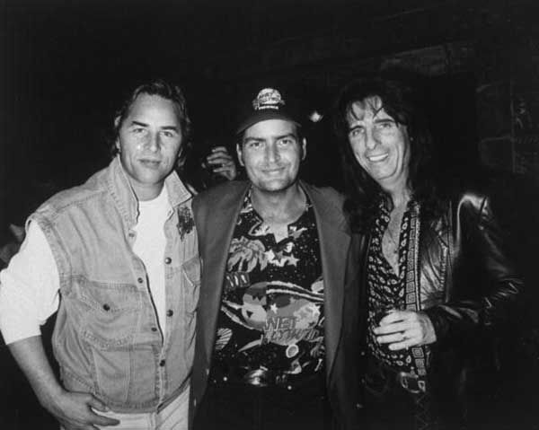 Don Johnson, Charlie Sheen and Alice Cooper at a Planet Hollywood opening, 1994.