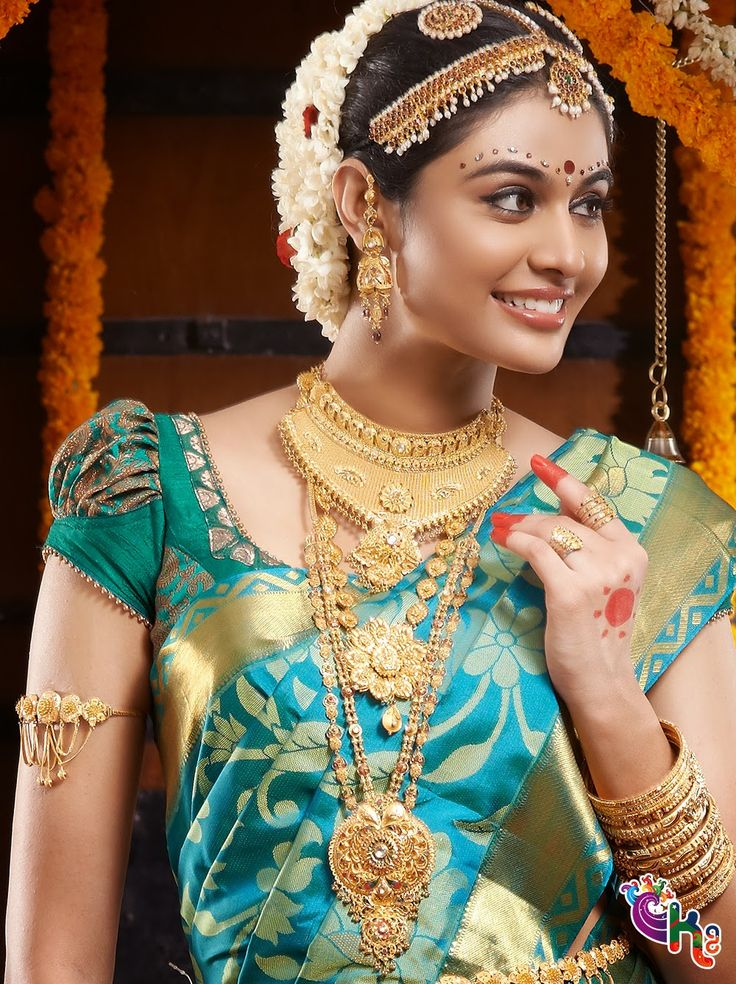 South indian Bride with silk saree and jewallary. Love the blouse design...