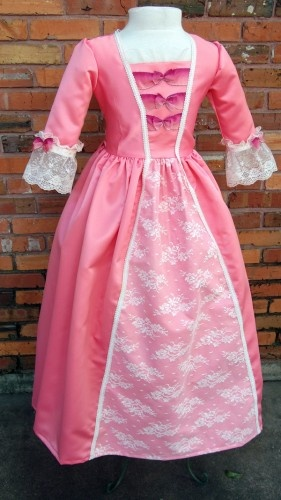Colonial gown, similar to the American Girl's Elizabeth.  With a little maturity and muting, this could be a good June Dress