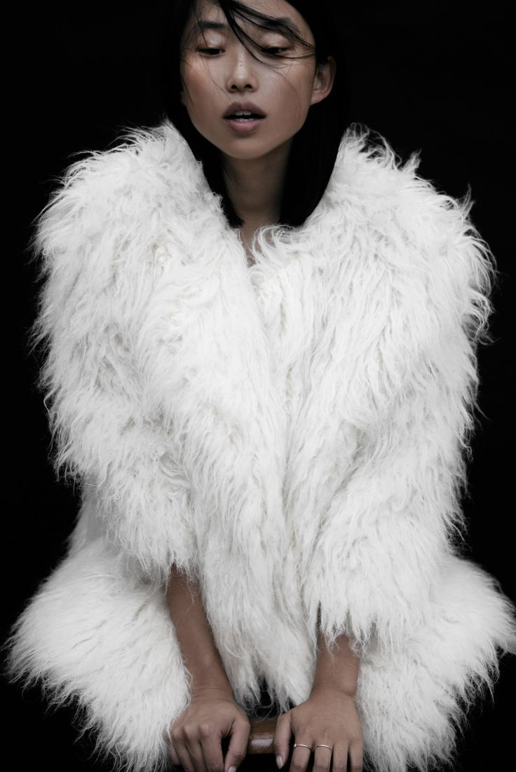 Margaret Zhang is a beauty in this fuzzy white coat #style #fashion