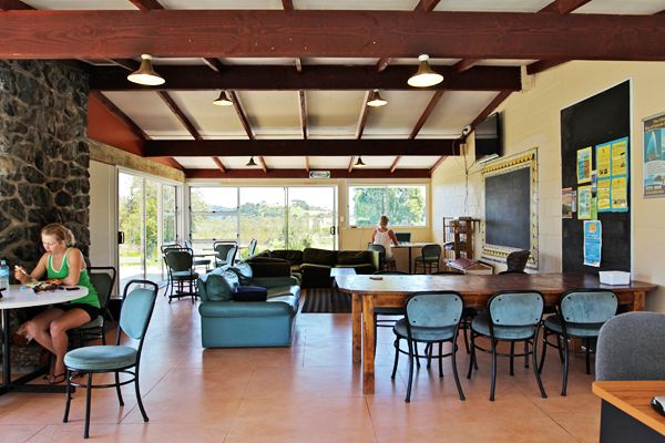 The Lodge | Russell - Orongo Bay Holiday Park. Our spacious Lodge lounge and dining area features a large stone fireplace with log fires during winter and a 42 inch TV connected to freeview.