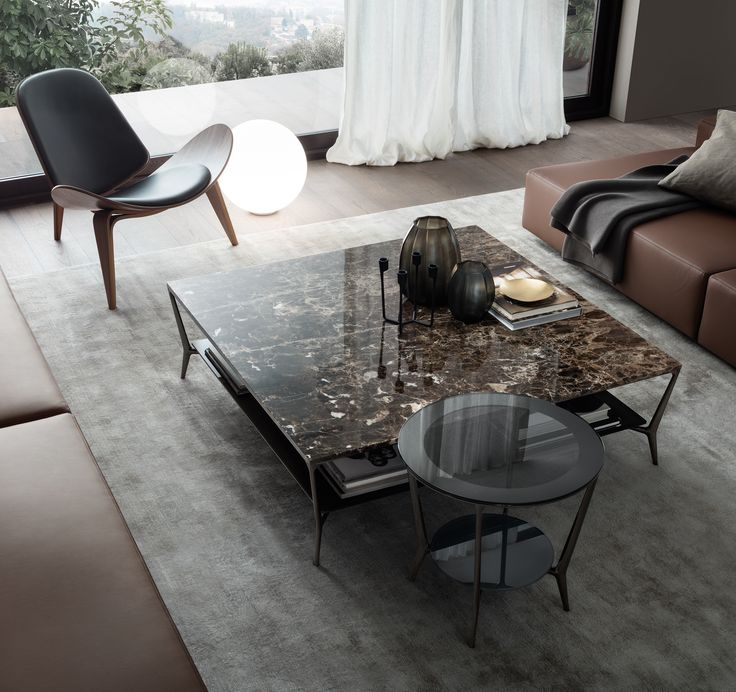 #Rimadesio Planet round table with black nickel structure, grey transparent top, perimetral frame with silver finish, lower top grigio scuro glossy lacquered glass. Squared coffee table with black nickel structure, emperador marble top, lower top in moro glossy lacquered glass.