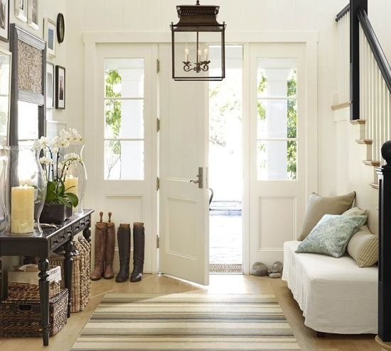 Lighting Image: homesbynectar.com   Proper lighting is always essential, and your entryway is no exception.  A well lit home is more inviting and cheery as you welcome visitors into your space.  When it comes to choosing the lighting for your front entrance, anything goes – from overhead fixtures and chandeliers, to wall sconces or table …