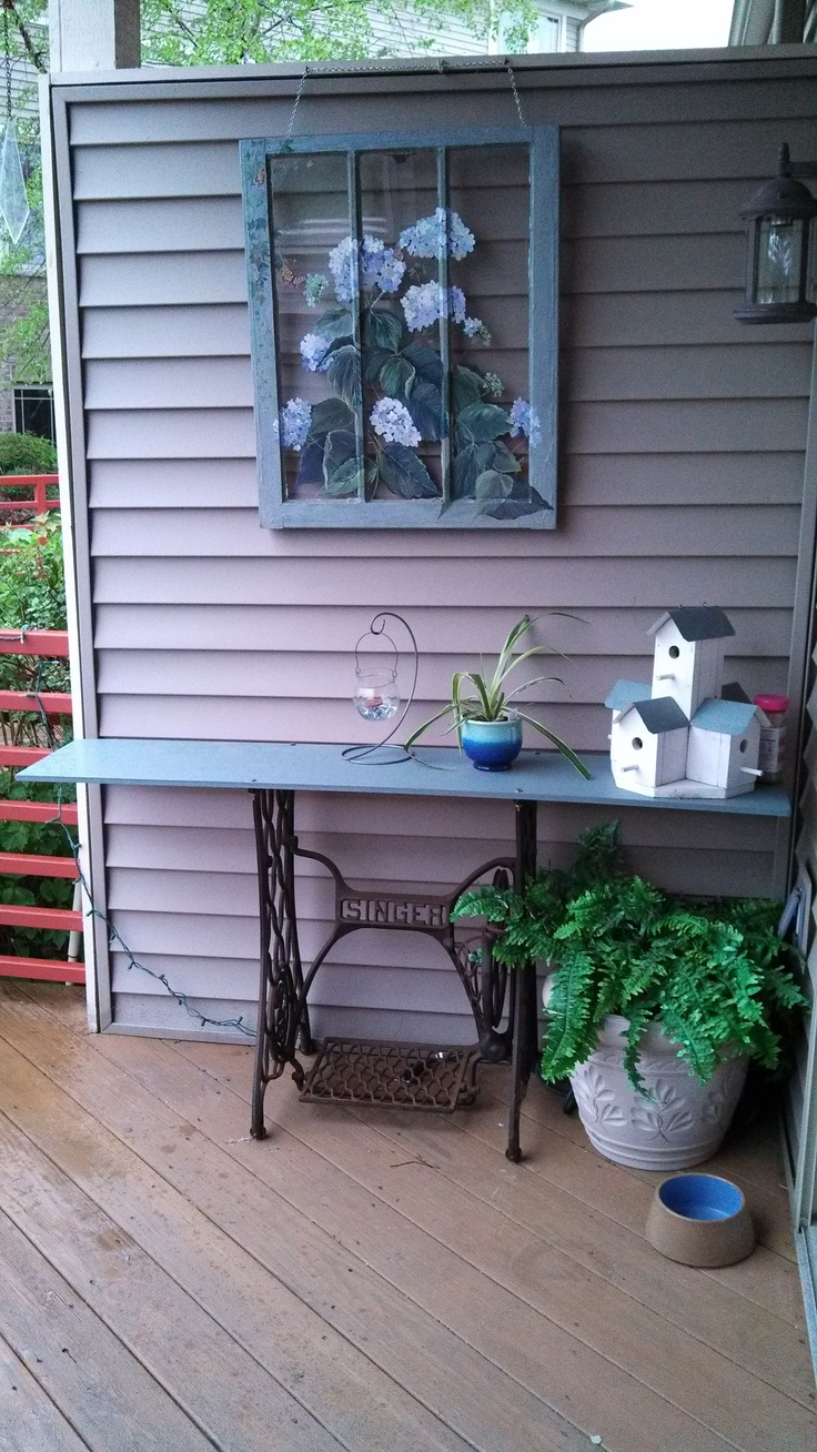 Deck decorations - use of Singer sewing machine stand.