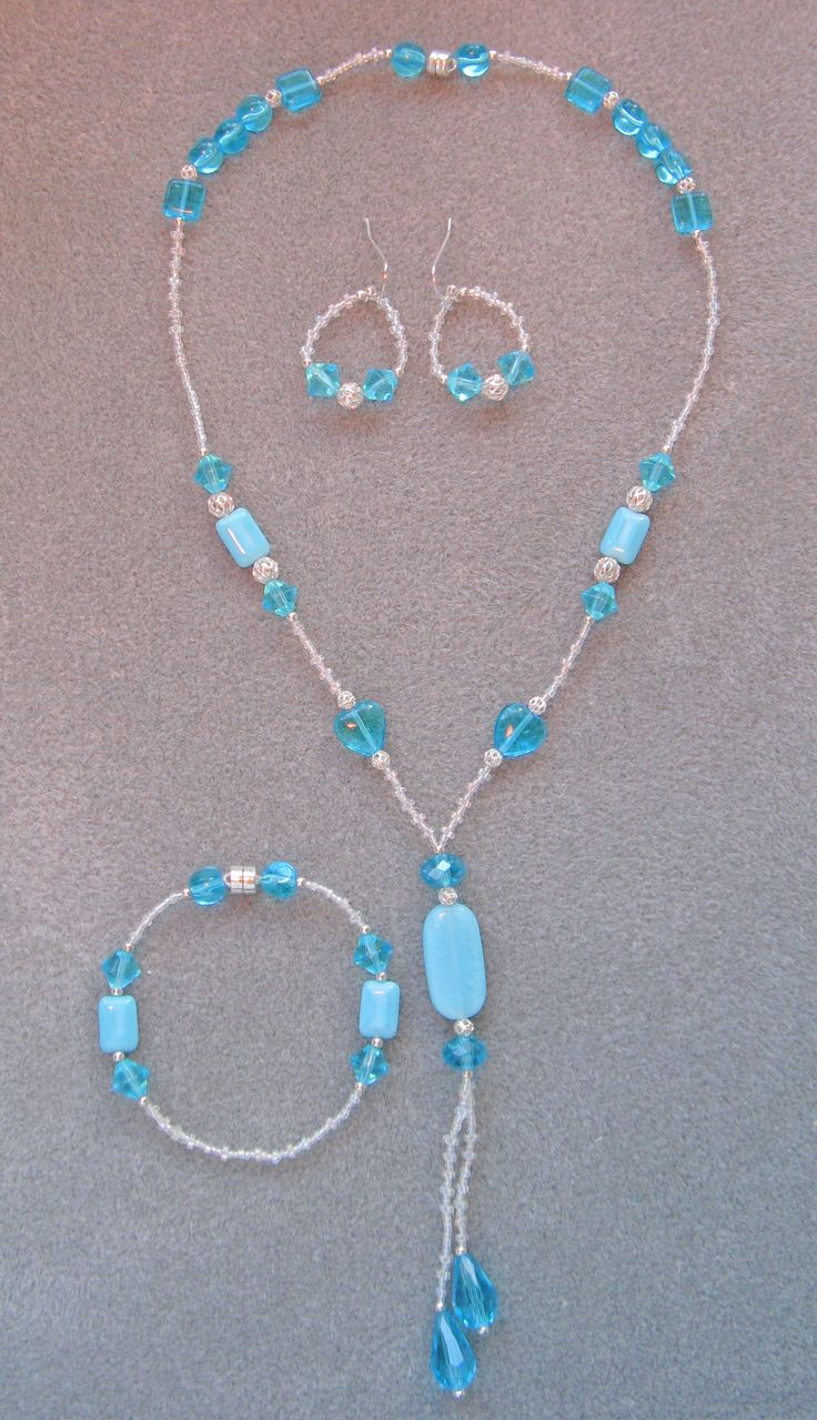 Blue necklace, bracelet & earrings.  I designed it so that the bracelet can be added to the necklace to make it longer.