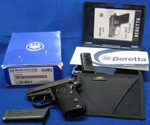 Photo of Beretta 3032 Tomcat 32 ACP semi-auto pistol, along with some related items. - Photo © Russ Chastain
