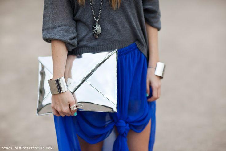 silver clutch & blue skirt