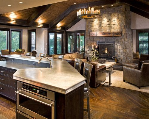 looove this open kitchen with the fireplace in the living area.